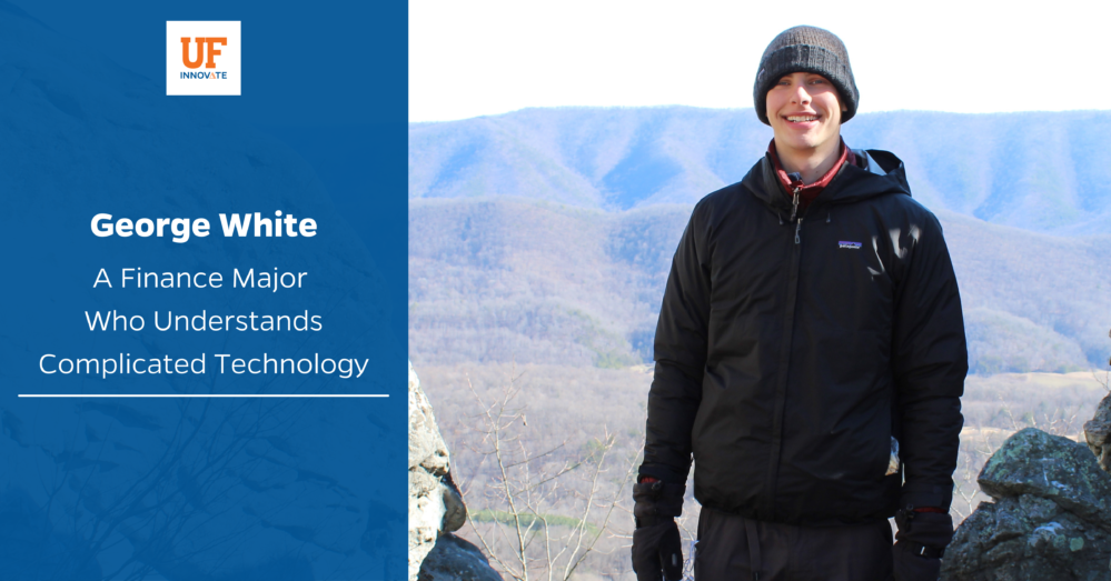 Intern George White is pictured at the top of a mountain he's climbed